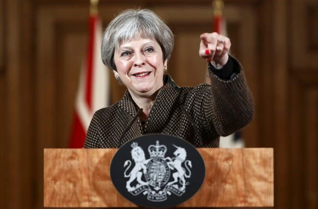 "Britain's Prime Minister Theresa May gestures during a press conference in 10 Downing Street, London, Saturday, April 14, 2018. British Prime Minister Theresa May says the need to act quickly and protect ""operational security"" led her to strike Syria without a prior vote in Parliament. (Simon Dawson/Pool Photo via AP)"
