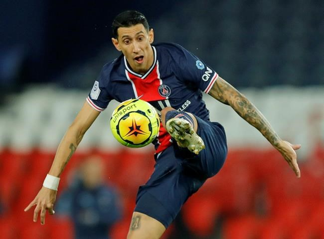 PSG's Angel Di Maria controls the ball during the French League One soccer match between Paris Saint-Germain and Rennes at the Parc des Princes in Paris, France, Saturday, Nov. 7, 2020. (AP Photo/Christophe Ena)