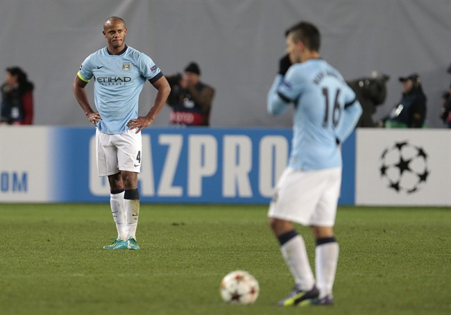 Manchester City's Vincent Kompany, left, reacts after CSKA's Bebras Natcho scored a penalty during the Champions League Group E soccer match between CSKA Moscow and Manchester City at Arena Khimki stadium in Moscow, Russia, Tuesday Oct. 21, 2014. (AP Photo/Ivan Sekretarev)