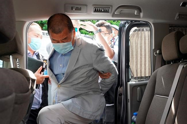 Hong Kong media tycoon Jimmy Lai, who founded local newspaper Apple Daily, gets into a car after being arrested by police officers at his home in Hong Kong, Monday, Aug. 10, 2020. Hong Kong police arrested Lai and raided the publisher's headquarters Monday in the highest-profile use yet of the new national security law Beijing imposed on the city after protests last year. (AP Photo)