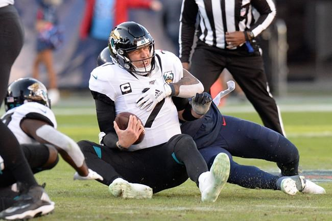 Jacksonville Jaguars quarterback Nick Foles (7) is sacked by Tennessee Titans linebacker Harold Landry for an 8-yard loss in the first half of an NFL football game Sunday, Nov. 24, 2019, in Nashville, Tenn. (AP Photo/Mark Zaleski)