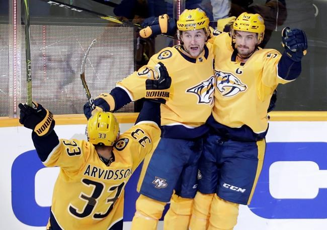Nashville Predators left wing Filip Forsberg (9), of Sweden, celebrates after scoring a goal against the St. Louis Blues in the second period of an NHL hockey game Sunday, Feb. 10, 2019, in Nashville, Tenn. (AP Photo/Mark Humphrey)