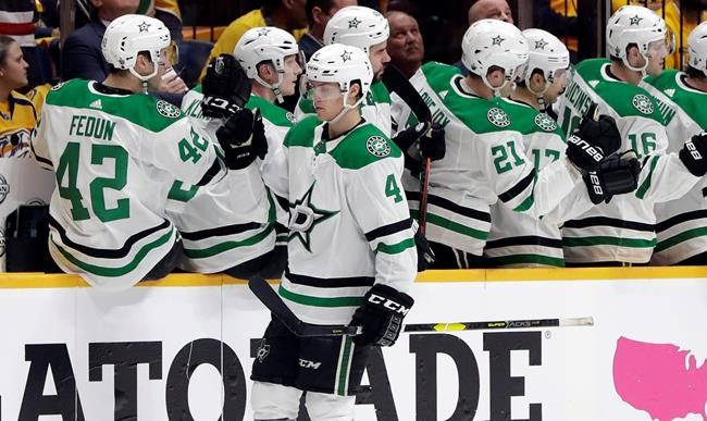 Dallas Stars defenseman Miro Heiskanen (4), of Finland, is congratulated after scoring a goal against the Nashville Predators during the second period in Game 1 of an NHL hockey first-round playoff series Wednesday, April 10, 2019, in Nashville, Tenn. (AP Photo/Mark Humphrey)