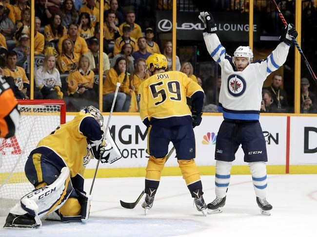 Winnipeg Jets center Paul Stastny (right) celebrates after teammate Tyler Myers scored a goal against Nashville Predators goalie Pekka Rinne (left) during the first period in Game 7 of an NHL hockey second-round playoff series Thursday, May 10, 2018, in Nashville, Tenn. Also defending for the Predators was Roman Josi (59), of Switzerland. (Mark Humphrey / The Associated Press files)