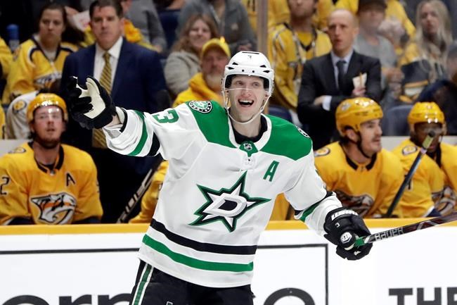 Dallas Stars defenseman John Klingberg (3), of Sweden, celebrates after teammate Miro Heiskanen scored a goal against the Nashville Predators during the third period in Game 1 of an NHL hockey first-round playoff series Wednesday, April 10, 2019, in Nashville, Tenn. The Stars won 3-2. (AP Photo/Mark Humphrey)