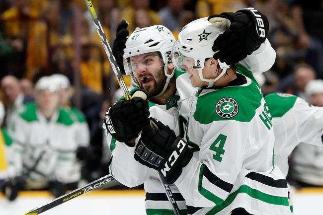 Dallas Stars right wing Alexander Radulov (47), of Russia, celebrates with defenseman Miro Heiskanen (4), of Finland, after Heiskanen scored his second goal of the night against the Nashville Predators, during the third period in Game 1 of an NHL hockey first-round playoff series Wednesday, April 10, 2019, in Nashville, Tenn. The Stars won 3-2. (AP Photo/Mark Humphrey)