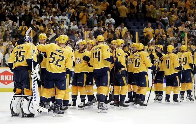 Nashville Predators players celebrate after defeating the Colorado Avalanche in Game 2 of an NHL hockey first-round playoff series Saturday, April 14, 2018, in Nashville, Tenn. (AP Photo/Mark Humphrey)