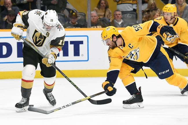 Nashville Predators defenseman Roman Josi (59), of Switzerland, pokes the puck away from Vegas Golden Knights right wing Reilly Smith (19) during the first period of an NHL hockey game Saturday, Feb. 1, 2020, in Nashville, Tenn. (AP Photo/Mark Zaleski)