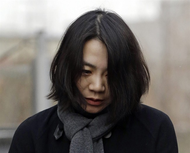 FILE - In this Dec. 12, 2014 file photo, Cho Hyun-ah, who was head of cabin service at Korean Air and the oldest child of Korean Air Chairman Cho Yang-ho, speaks to the media upon her arrival for questioning at the Aviation and Railway Accident Investigation Board office of Ministry of Land, Infrastructure and Transport in Seoul, South Korea. South Korean prosecutors are seeking to detain the former executive at Korean Air Lines Co. who forced a flight to return over a bag of macadamia nuts and a current executive for attempts to cover up the