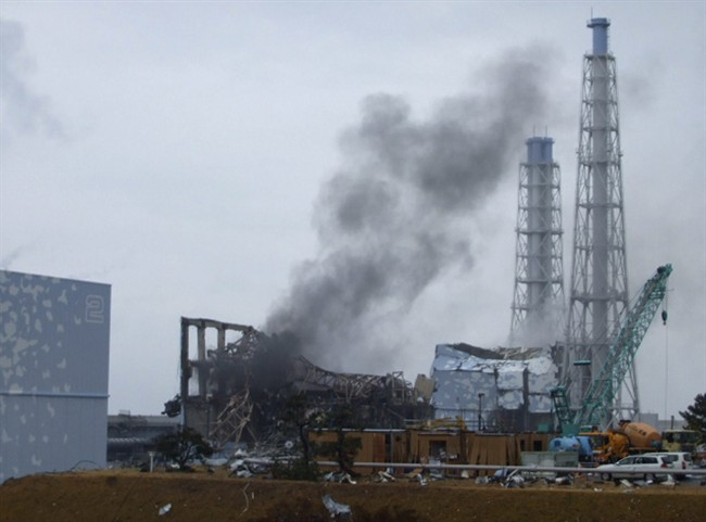 FILE - In this Monday, March 21, 2011 file photo released by Tokyo Electric Power Co., gray smoke rises from Unit 3 of the tsunami-stricken Fukushima Dai-ichi nuclear power plant in Okuma, Fukushima prefecture, Japan. The Japanese government failed to adequately utilize radiation threat forecasts in the early days of its nuclear crisis and allowed thousands of residents - including hundreds of schoolchildren - to remain in areas it had ample reason to believe put them in serious danger. (AP Photo/Tokyo Electric Power Co., File)
