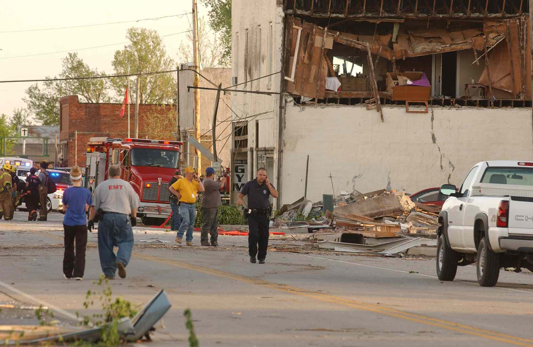 First responders, volunteers and firemen gather on Main Street in Quapaw, Okla., after a tornado struck the city on Sunday evening.