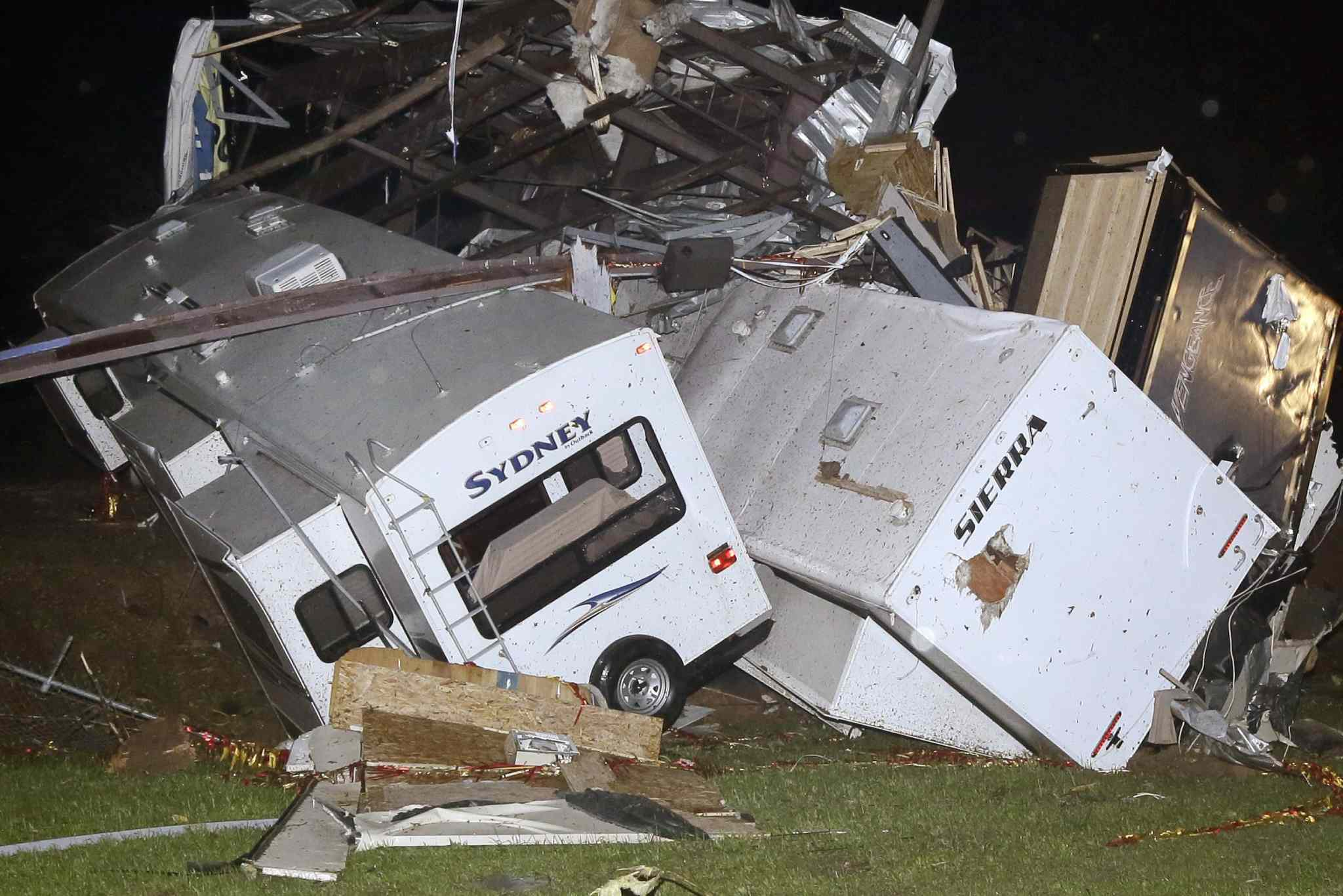 Travel trailers and motor homes are piled on top of each other at Mayflower RV in Mayflower, Ark., Sunday, after a powerful storm system rumbled through the central and southern United States on Sunday, spawning tornadoes.