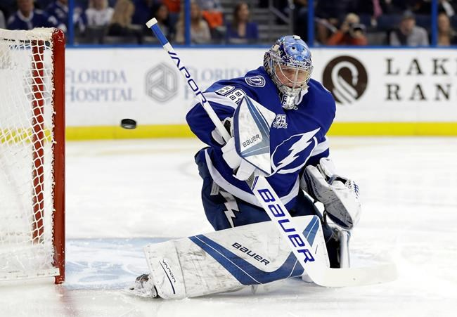 Tampa Bay Lightning goaltender Andrei Vasilevskiy (88), of Russia, makes a blocker save on a shot by the Calgary Flames during the first period of an NHL hockey game Thursday, Jan. 11, 2018, in Tampa, Fla. (AP Photo/Chris O'Meara)
