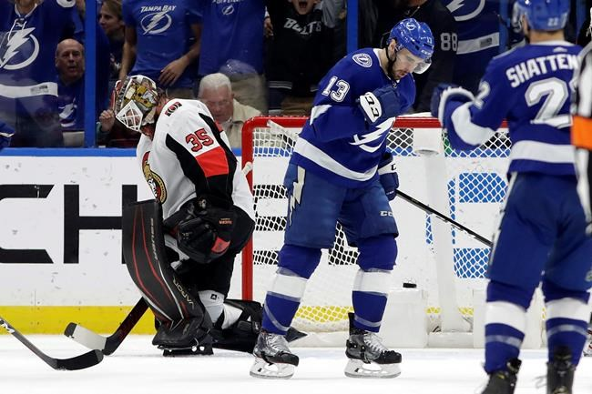 Tampa Bay Lightning center Cedric Paquette (13) pumps his fist after scoring past Ottawa Senators goaltender Marcus Hogberg (35) during the first period of an NHL hockey game, Tuesday, Dec. 17, 2019, in Tampa, Fla. (AP Photo/Chris O'Meara)