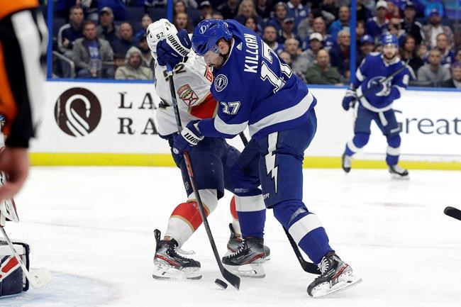 Tampa Bay Lightning left wing Alex Killorn (17) scores in front of Florida Panthers defenseman MacKenzie Weegar (52) during the second period of an NHL hockey game Monday, Dec. 23, 2019, in Tampa, Fla. (AP Photo/Chris O'Meara)