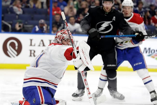 Montreal Canadiens goaltender Carey Price makes a save on a shot by the Tampa Bay Lightning during the second period of an NHL hockey game Saturday, Dec. 28, 2019, in Tampa, Fla. (AP Photo/Chris O'Meara)
