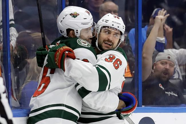 Minnesota Wild right wing Mats Zuccarello (36) celebrates his goal against the Tampa Bay Lightning with left wing Jason Zucker (16) during the third period of an NHL hockey game Thursday, Dec. 5, 2019, in Tampa, Fla. (AP Photo/Chris O'Meara)