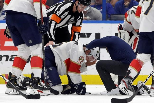 Blood pours out of Florida Panthers defenseman Anton Stralman's helmet after he was hit on the head by a slap shot during the third period of the team's NHL hockey game against the Tampa Bay Lightning on Monday, Dec. 23, 2019, in Tampa, Fla. (AP Photo/Chris O'Meara)