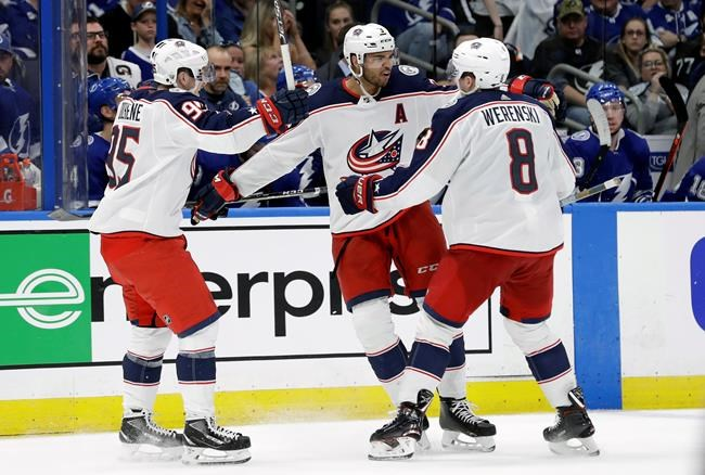 Columbus Blue Jackets defenseman Seth Jones (3) celebrates his goal against the Tampa Bay Lightning with defenseman Zach Werenski (8) and center Matt Duchene (95) during the third period of Game 1 of an NHL Eastern Conference first-round hockey playoff series Wednesday, April 10, 2019, in Tampa, Fla. (AP Photo/Chris O'Meara)