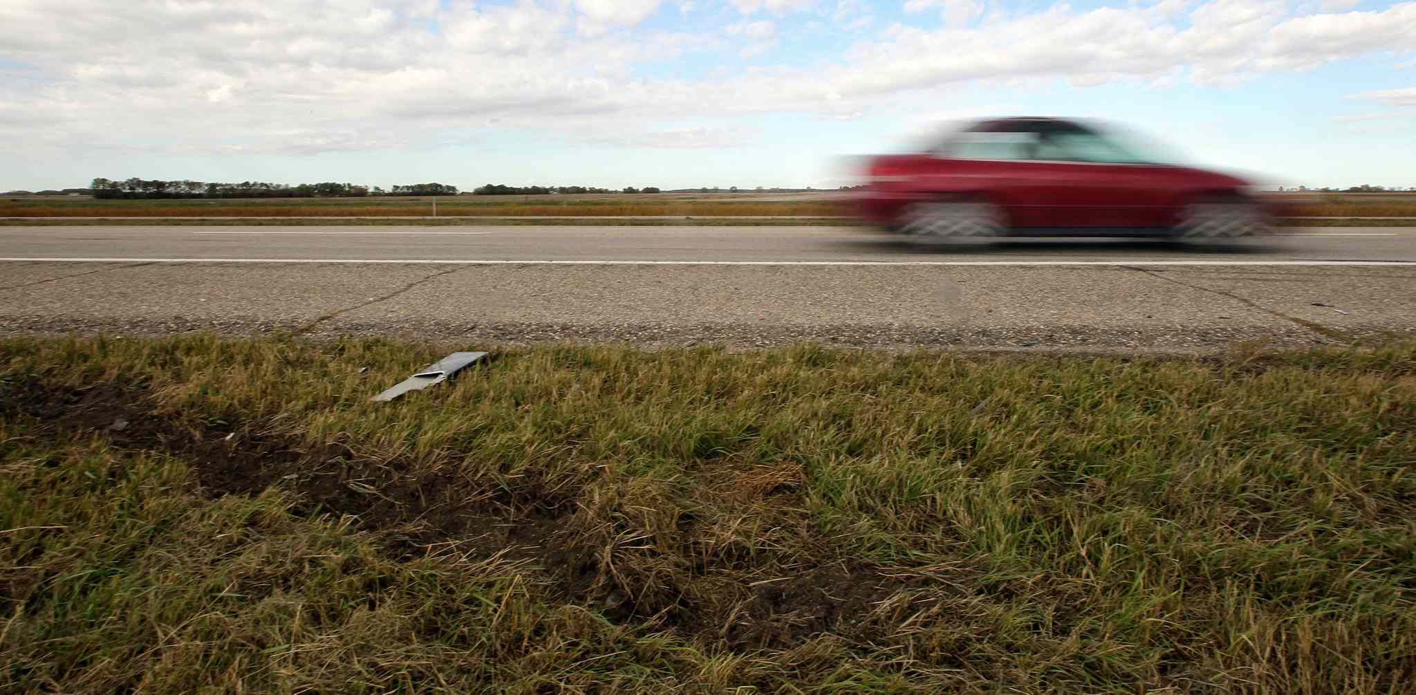 A gouge in the earth along the Trans-Canada Highway about two kilometres west of MacGregor marks the spot where a 17-year-old teen from Austin and a 14-year-old teen from Sidney died when a pickup truck slammed into the rear of the car they were driving in on Saturday.