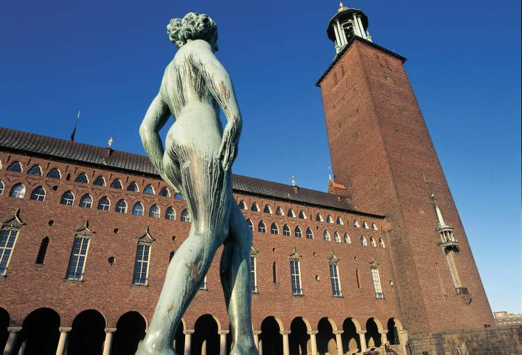 A statue stands outside city hall in Stockholm. Sweden is one of the four flush Nordic nations.
