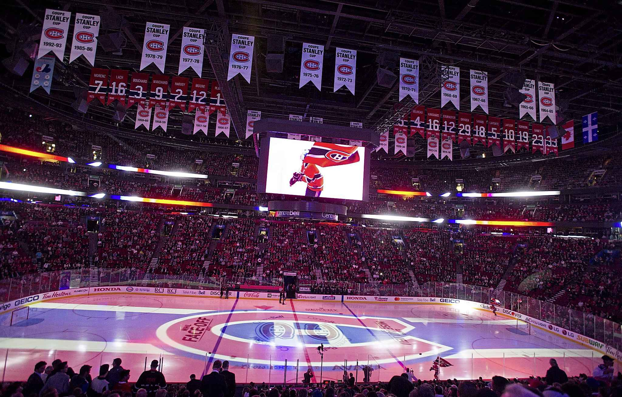 The Montreal Canadiens logo is projected onto the ice at the Bell Centre during a pre-game ceremony in Montreal in 2017. The Jets will be adding on-ice projection to their game-night experience, which has become a staple at most NHL rinks.
