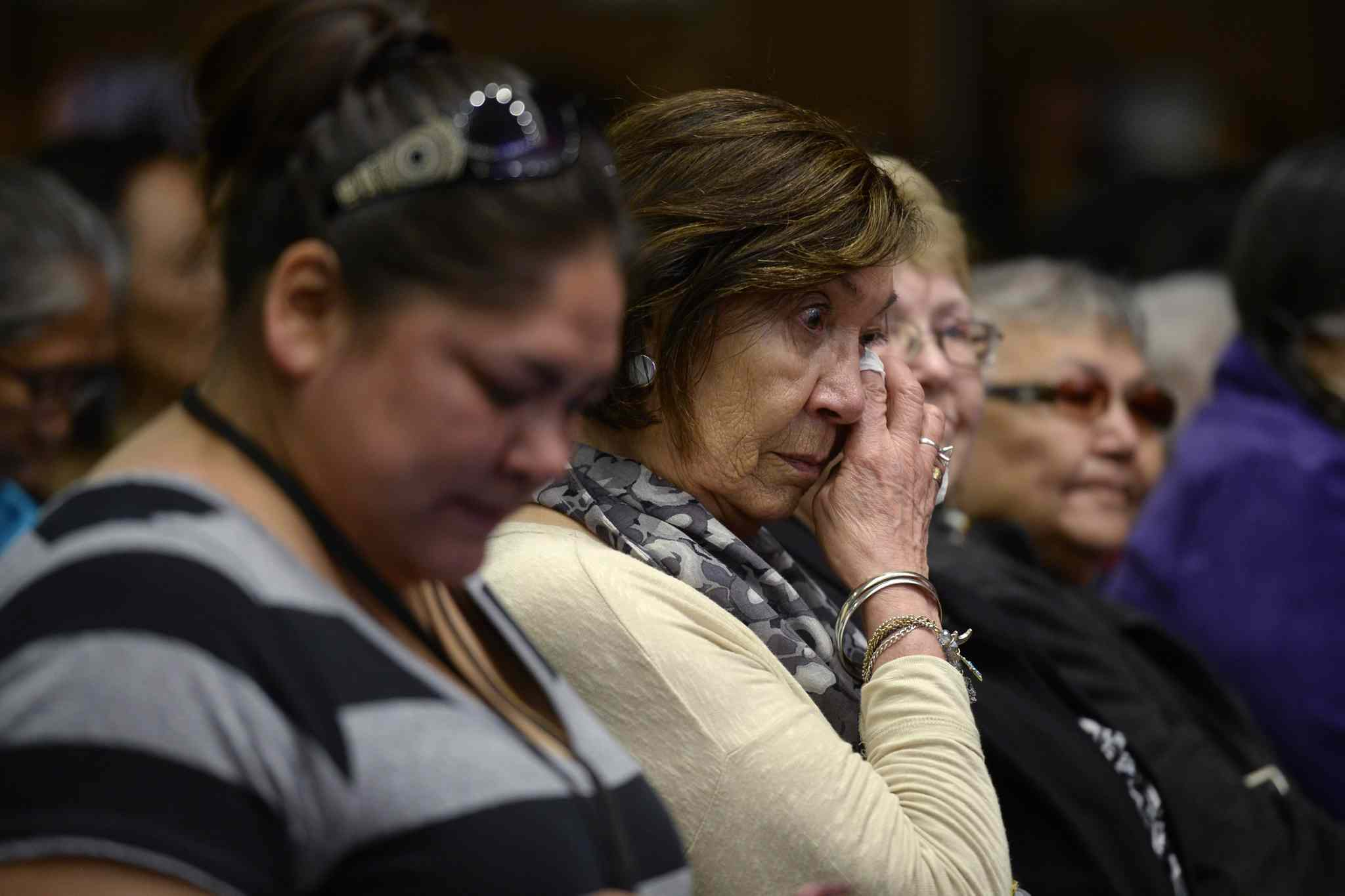 Residential school survivors and aboriginal women react as Truth and Reconciliation Commission chairman Justice Murray Sinclair speaks at the commission in Ottawa on Tuesday.