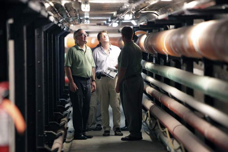 Manitoba Legislative Building manager Todd Miclash (right) takes Minister of Finance Stan Struthers (left) and reporter Bruce Owen on a tour of the tunnel underneath the Manitoba legislature that connects with other government buildings.