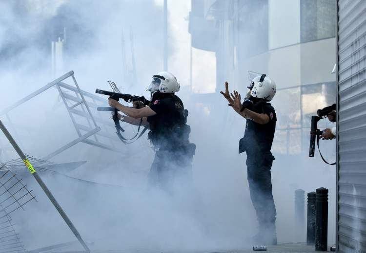 Turkish riot police fire tear gas during clashes at Taksim Square in Istanbul Tuesday.