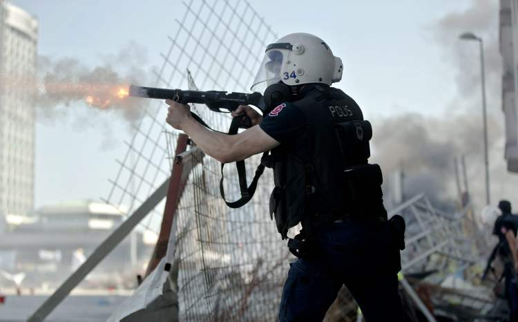 Hundreds of police in riot gear forced their way through barricades in Taksim Square early Tuesday, pushing many of the protesters who had occupied the square for more than a week into a nearby park. (Vadim Ghirda / The Associated Press)