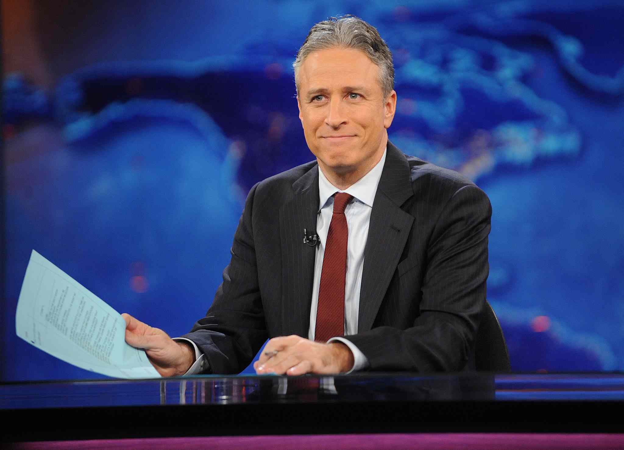 """This Nov. 30, 2011 file photo shows television host Jon Stewart during a taping of """"The Daily Show with Jon Stewart"""" in New York. Stewart said goodbye on Thursday after 16 years on Comedy Central's """"The Daily Show"""" that established him as America's foremost satirist of politicians and the media. (AP Photo/Brad Barket, File)"""