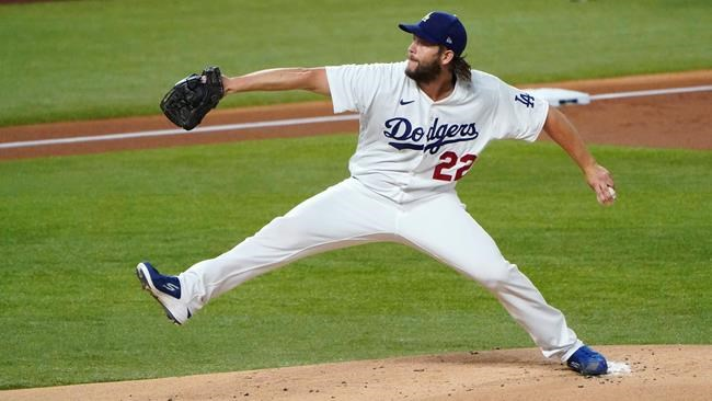 Los Angeles Dodgers starting pitcher Clayton Kershaw delivers during the first inning in Game 2 of a baseball National League Division Series Wednesday, Oct. 7, 2020, in Arlington, Texas. (AP Photo/Sue Ogrocki)