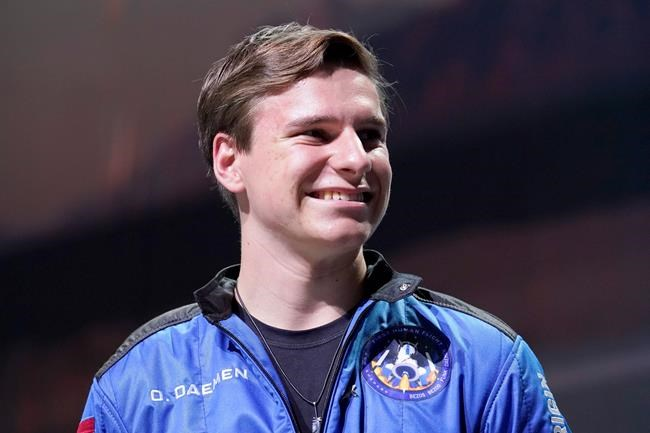 Oliver Daemen smiles as he during a post launch briefing where passengers described their flight experience from the spaceport near Van Horn, Texas, Tuesday, July 20, 2021. (AP Photo/Tony Gutierrez)