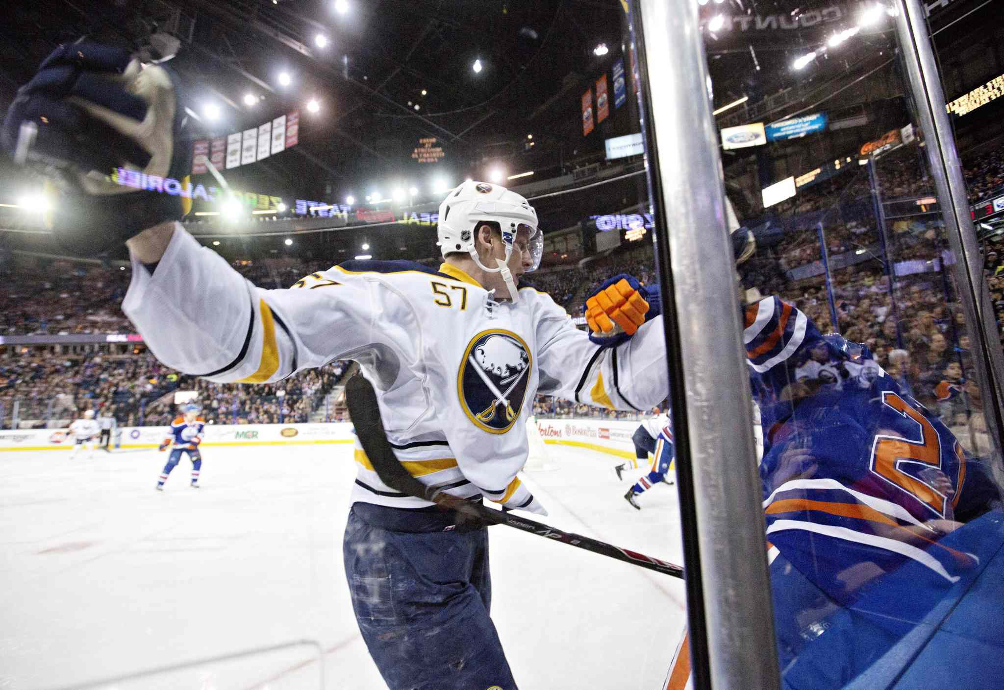 Buffalo Sabres Tyler Myers checks Edmonton Oilers Andrew Ference during a game in January.