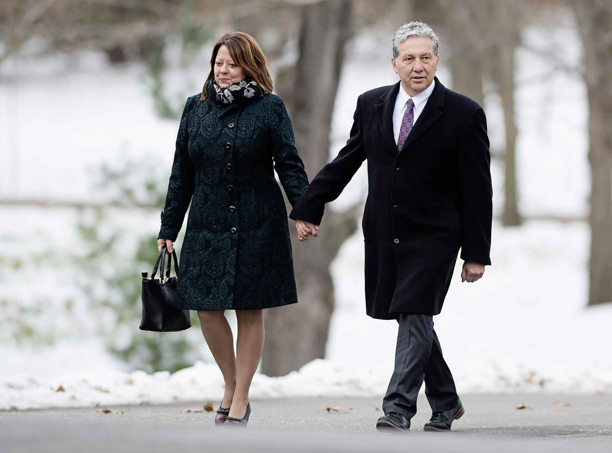 Liberal MP Dan Vandal (right), with his wife Brigitte Leger, arrives for the swearing in of the new cabinet at Rideau Hall in Ottawa on Wednesday.