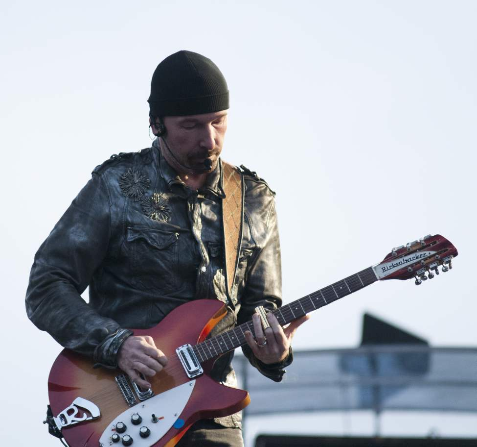 U2 guitarist The Edge performs with U2 in concert at Canad Inns Stadium Sunday night. (DAVID LIPNOWSKI / WINNIPEG FREE PRESS)