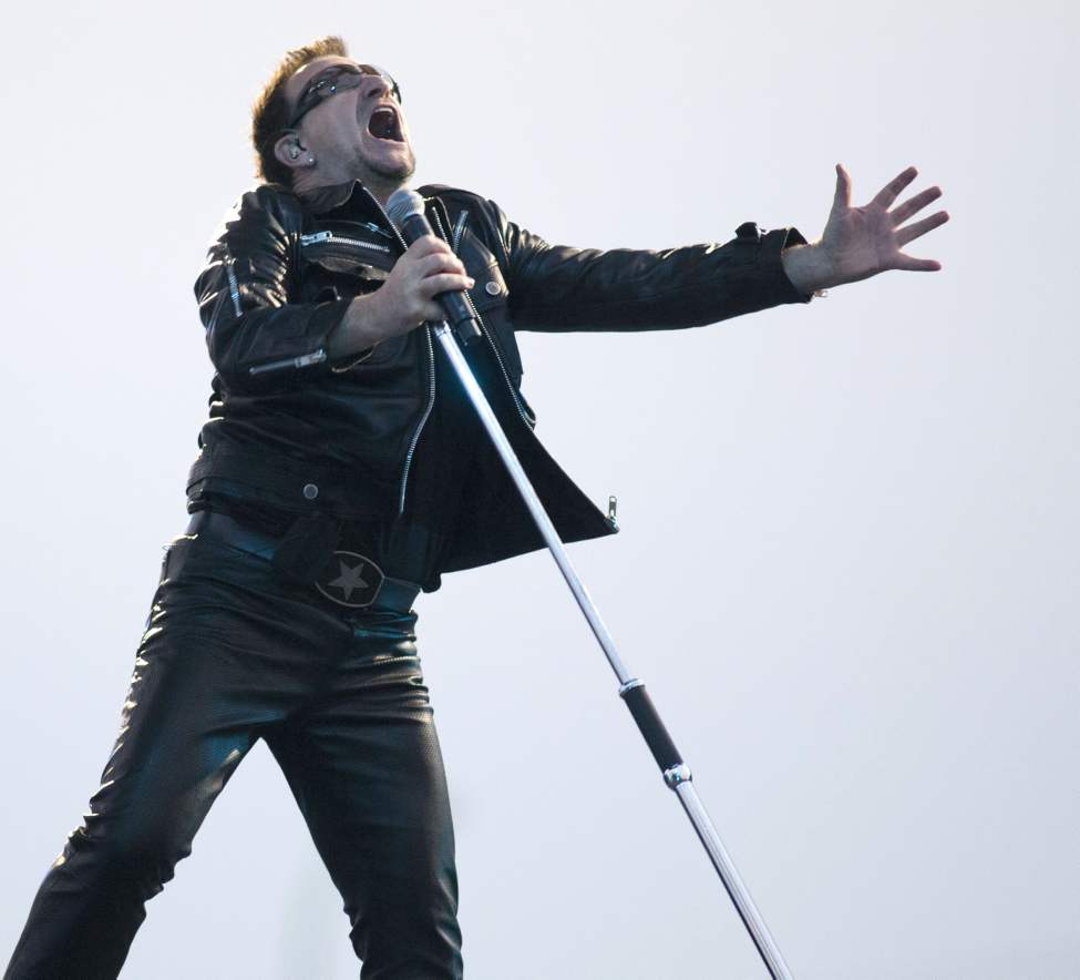 U2 lead singer Bono performs with U2 in concert at Canad Inns Stadium Sunday night. (DAVID LIPNOWSKI / WINNIPEG FREE PRESS)