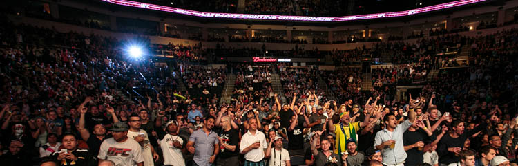 A sell-out crowd at MTS Centre cheers for Winnipeg fighter Roland Delorme. (Melissa Tait / Winnipeg Free Press)