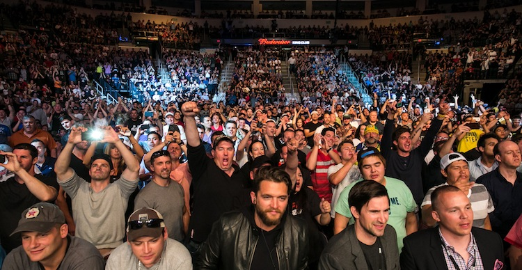 The crowd gets pumped up for the main event light heavyweight bout between Dan Henderson and Rashad Evans.