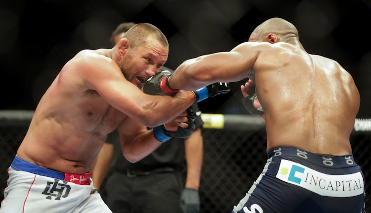 Dan Henderson (left) takes a shot from Rashad Evans.