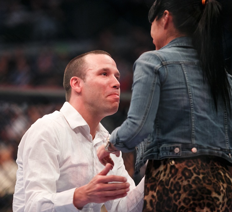 Marc-Andre Drolet, an MMA writer, is emotional after asking Kathy Spinks to marry him at the centre of the octagon. She said yes. (Melissa Tait / Winnipeg Free Press)