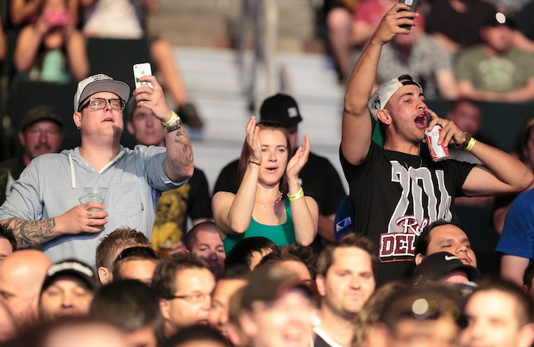 "A sell-out crowd at the MTS Centre screamed and booed for and against fighters at UFC 161. There were also shouts of ""Rolly, Rolly"" for local fighter Roland Delorme. (Melissa Tait / Winnipeg Free Press)"
