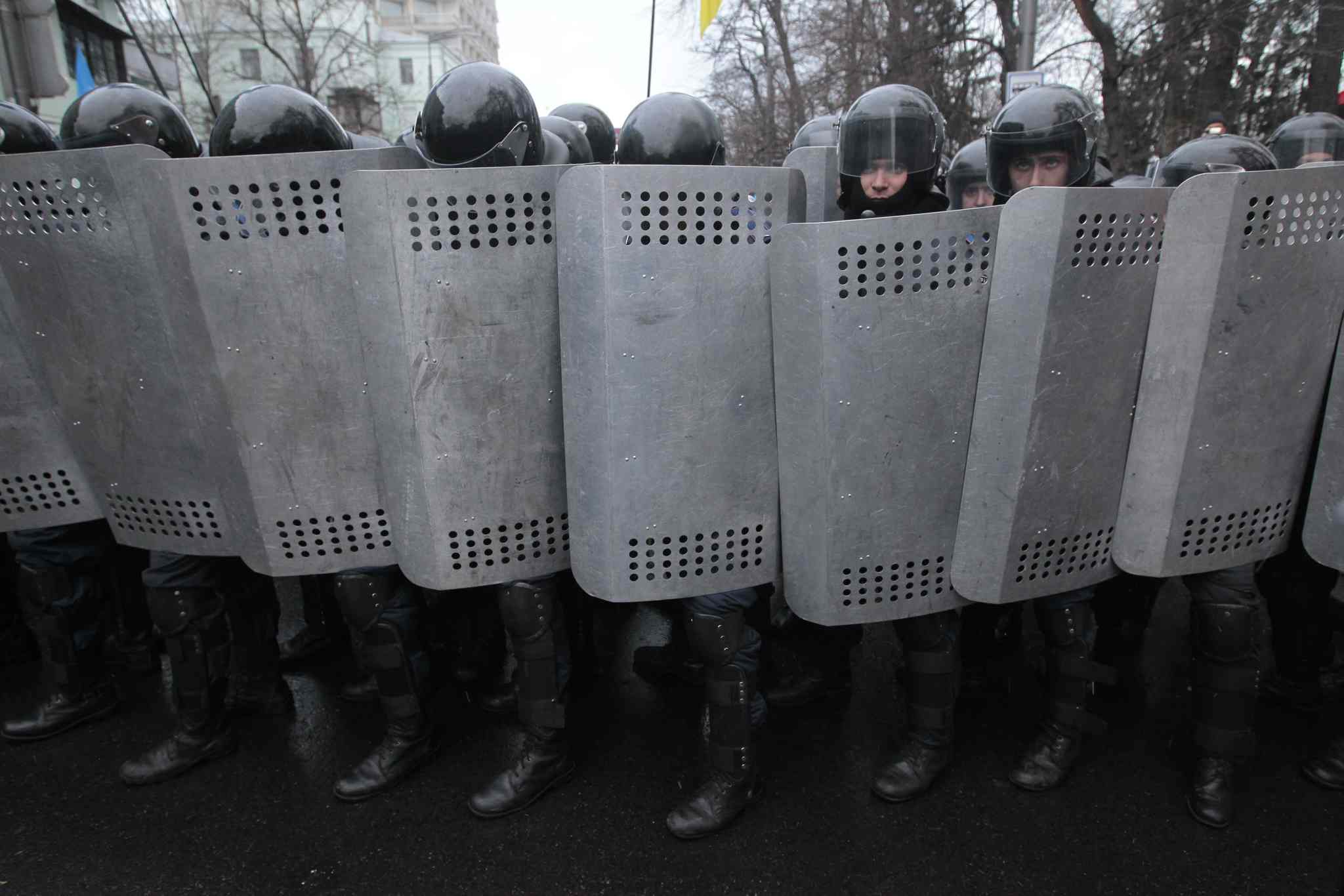 Riot police protect government buildings from Pro-European Union activists.