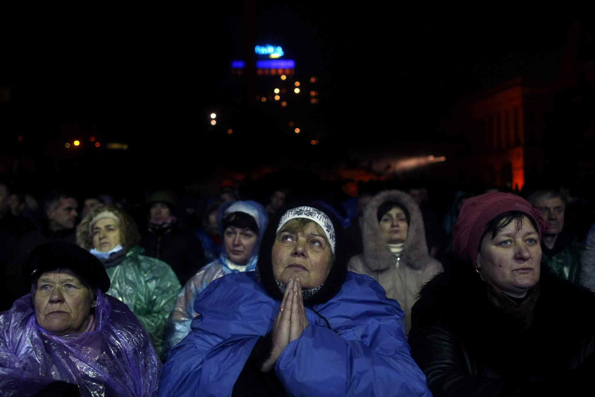 Anti-government protesters pause in prayer at Independence Square in Kyiv, Ukraine on Thursday. Ukraine's protest leaders and the president they aim to oust called a truce Wednesday, just hours after the military raised fears of a widespread crackdown with a vow to defeat