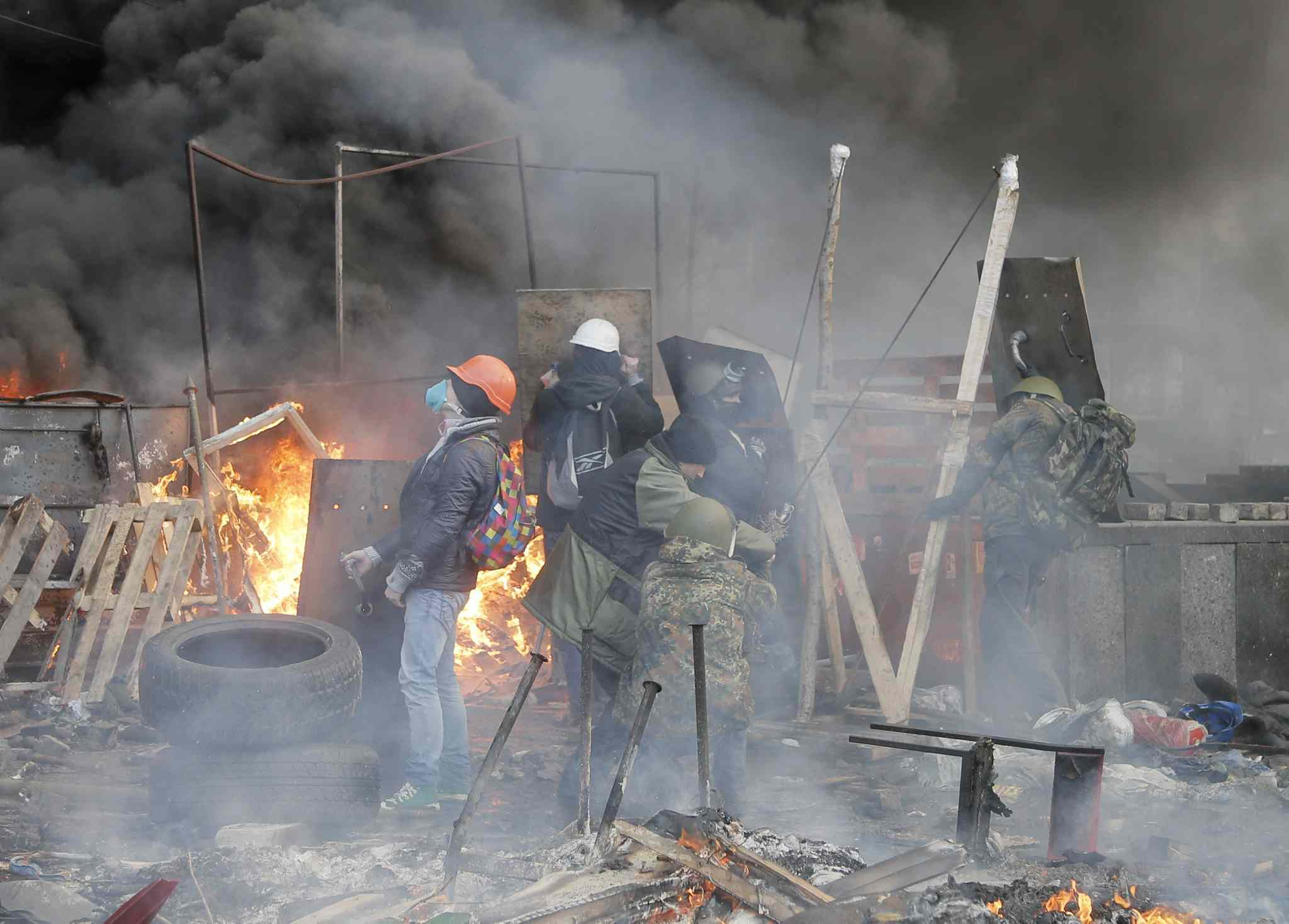 Anti-government protesters use a catapult during clashes with riot police in Kyiv's Independence Square, the epicentre of the country's current unrest, on Wednesday in Kyiv. The deadly clashes in Ukraine's capital have drawn sharp reactions from Washington, generated talk of possible European Union sanctions and led to a Kremlin statement blaming Europe and the West.