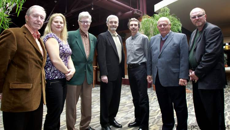 Some of the inductees into the Manitoba Hockey Hall of Fame 2011 are from left, officials Bud Ulrich and Laura Loeppky, media Bob Picken and Curt Keilback, player Karl Friesen, and builders Ted Foreman and Don Dietrich.