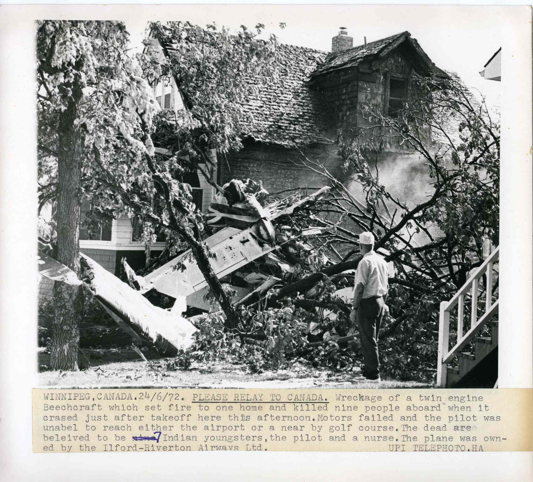 Wreckage of a twin engine Beechcraft which set fire to one home and killed nine people on board when it crashed just after takeoff in 1972.