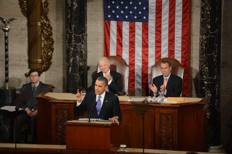 With Vice-President Joe Biden, left, and House Speaker John Boehner, right, behind him, U.S. President Barack Obama addresses a joint session of Congress as he delivers his State of the Union address on Tuesday at the Capitol building in Washington.