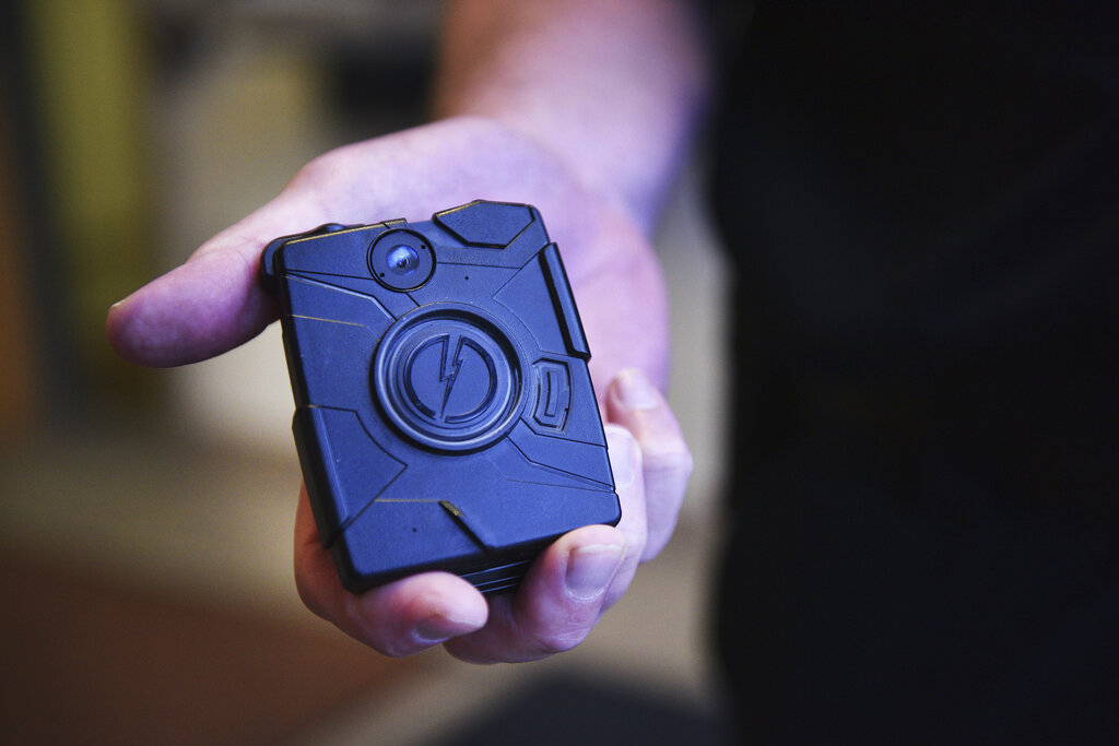 Calls for defunding and abolition of police have been accompanied in recent months by more moderate calls for reformation, such as all officers wearing body cameras (above). (Briana Sanchez / The Argus Leader files)