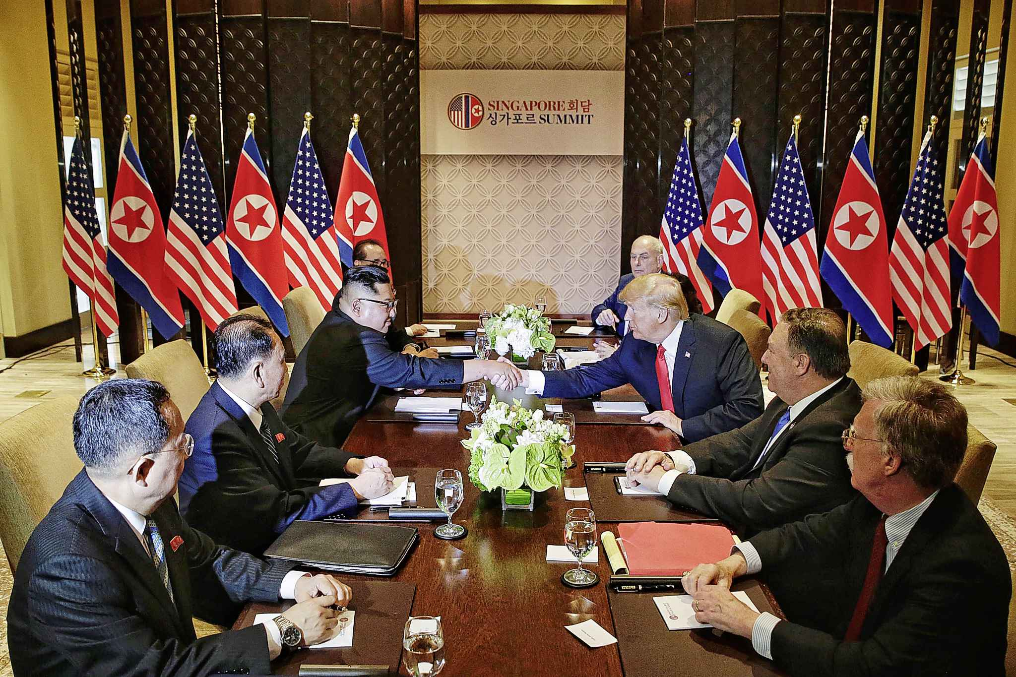 North Korea's Kim Jong Un, third from left, shakes hands with U.S. President Donald Trump, third from right, in Singapore. (Kevin Lim/The Straits Times/Zuma Press/TNS)
